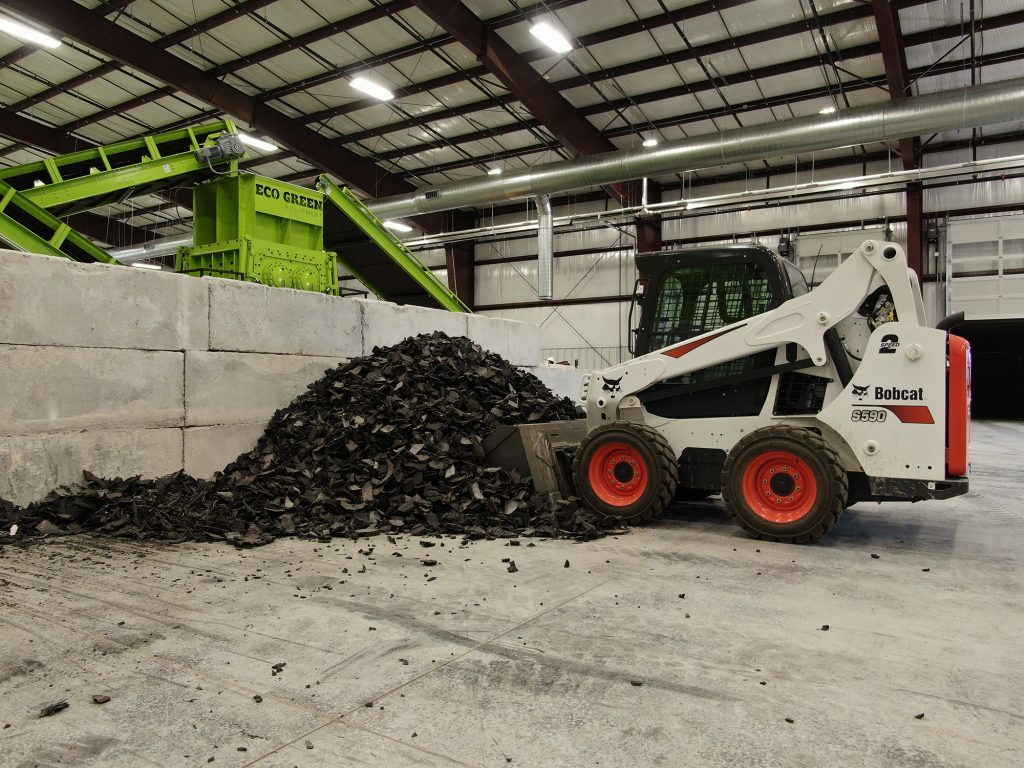 bobcat moving scrap tire at ecoshred